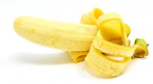 A half-peeled banana ready to eat for its benefits to the body!