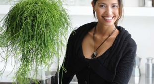 Beautiful woman with nice Rhipsalis indoor plant.